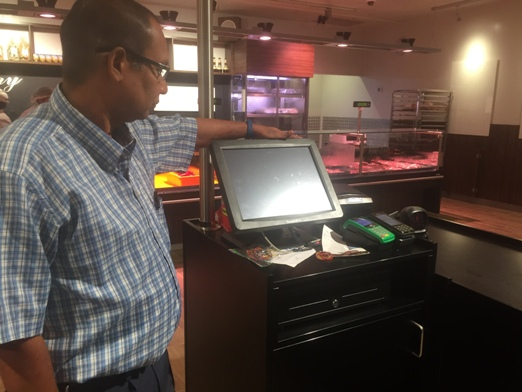 The owner of Madang Butchery admiring his new POS System